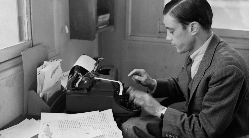Photo by Robert Delvac of mr. Bradlee working at his typewriter on Aug. 3, 1956.