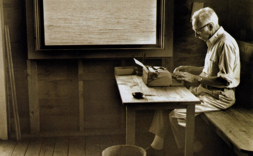 EB White writing in a cabin